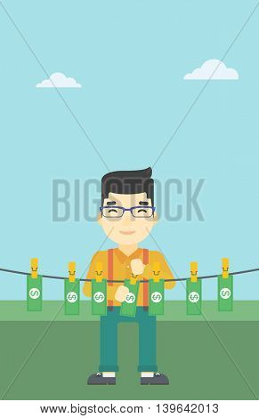 An asian young businessman drying banknotes on the clothesline on the background of blue sky. Man loundering money. Vector flat design illustration. Vertical layout.
