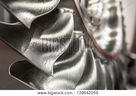 The blades of the turbine wheel, close-up shot. Shallow depth of field.
