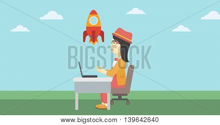 An asian young business woman sitting at the table and looking at a flying rocket. Business woman working on laptop. Business start up concept. Vector flat design illustration. Horizontal layout.