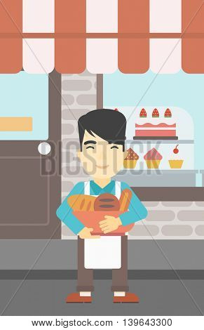 An asian young baker holding basket with bakery products. Baker standing in front of bakery. Baker with bowl full of bread. Vector flat design illustration. Vertical layout.