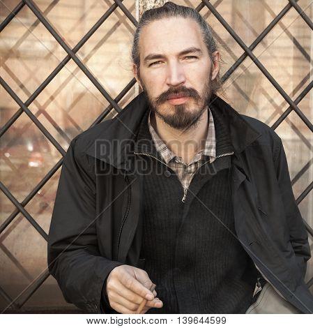 Bearded Asian Man Smoking Cigarette