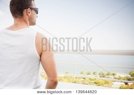Sporty Caucasian Man In White Shirt And Sunglasses