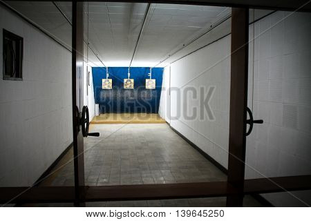 Gun Gallery Shooting Range With Paper Targets.