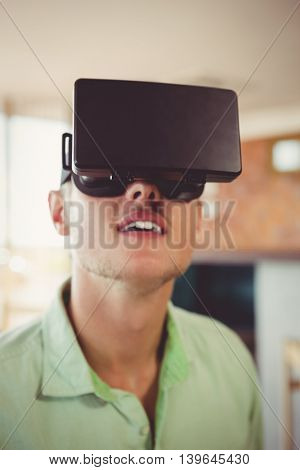 Man using virtual glasses in restaurant