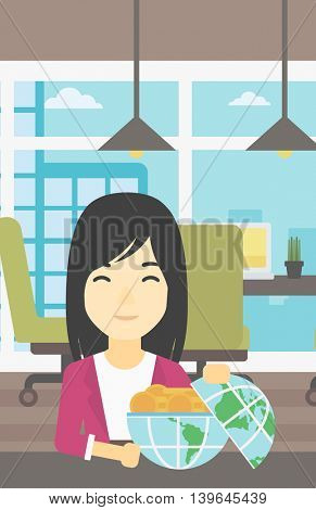 An asian  young business woman sitting at the table in office with a Earth globe full of gold coins. Concept of global business. Vector flat design illustration. Vertical layout.