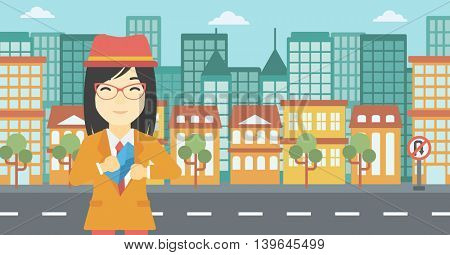 An asian  young business woman putting an envelope in her pocket on a city background. Vector flat design illustration. Horizontal layout.