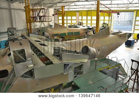 Kiev Ukraine - July 7 2012: Planes being assembled in hangar after a serious check and equipment upgrade