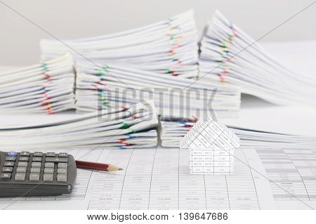 Brown Pencil With Calculator And House On Finance Account