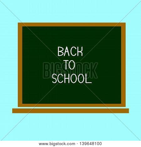 Back to school, written on blackboard with chalk on a light green background