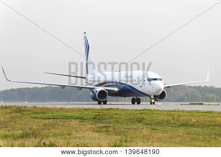 MOSCOW, RUSSIA - SEPTEMBER 26, 2014: Nordstar airlines Boeing-737 taxiing. Plane makes taxiing on taxiway Domodedovo International Airport.
