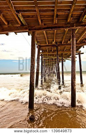 beach with old wooden pier in america