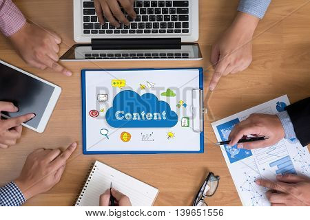 Business Team Hands At Work With Financial Reports And A Laptop, Content Marketing, Online Concept