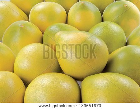 Pomelo juicy summer fruit raw food on background
