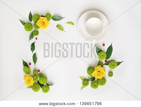 Cup For Coffee Or Tea With Wreath Frame From Roses And Other Flowers.