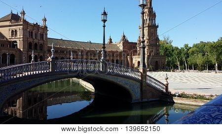 Seville, Spain - June 22, 2016: Plaza de Espana in Seville, Spain. Tourists are visiting the Plaza de Espana.