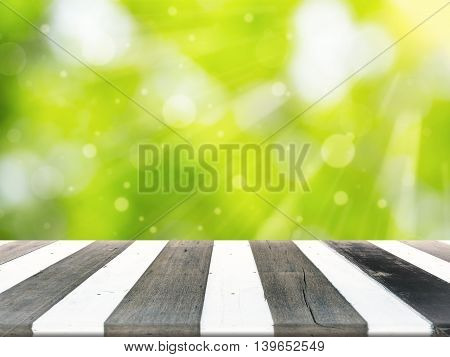 Wood Table For Display Product And Blurry Green In Background