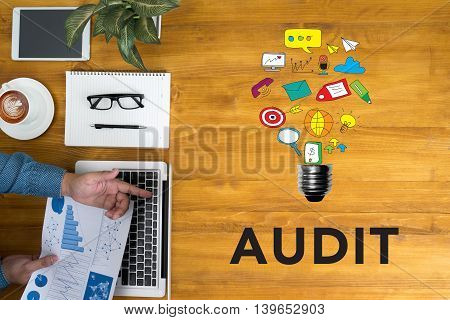Businessman Working At Office Desk Single Word Audit