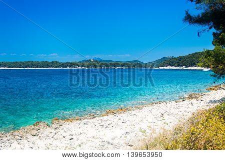 Turquoise blue lagoon on the island of Losinj, Croatia, seaside landscape