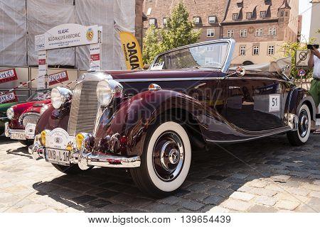 Nurnberg Bavaria / Germany - July 19th 2014: burgundy Mercedes-Benz 170S cabriolet A vintage car at Sud - Rallye- Historic event in Nurnberg