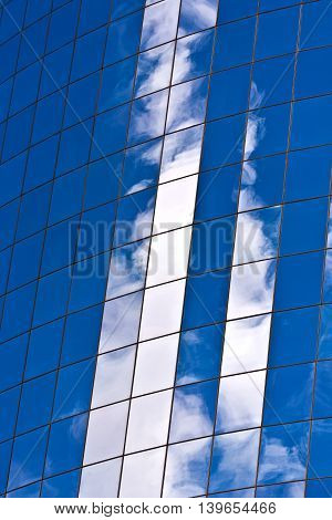 facade of Skyscraper with reflection of sky in New York