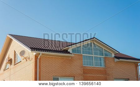 roof of the house on a background of blue sky