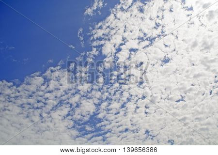 Summer day and the white clouds that travel blue sky.