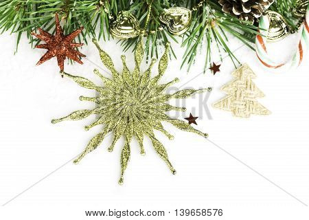 Christmas background with fir tree, star, pine cones over white. Christmas concept with copy space for text.