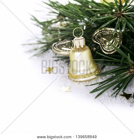 Christmas composition with golden bell and branch of christmas tree. Concept with copy space for text.