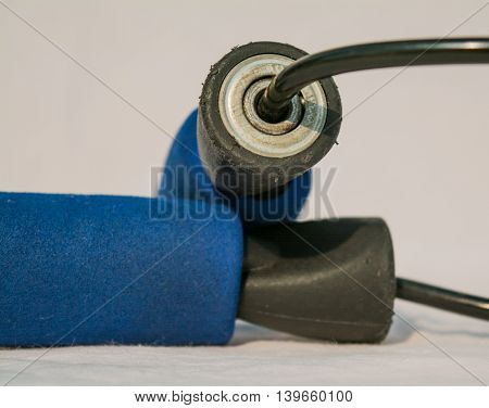 Blue old rusty jumping rope with sponges