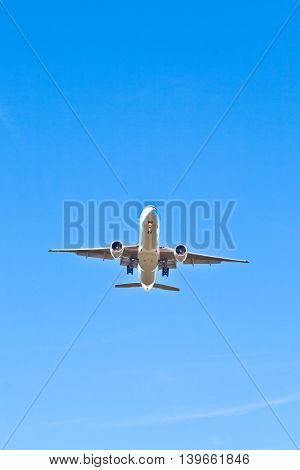 aircraft in landing approach under clear blue sky