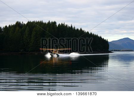Seaplane landing near Kodiak City on Kodiak Island in Alaska