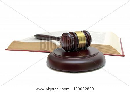 gavel and open book isolated on white background. horizontal photo.