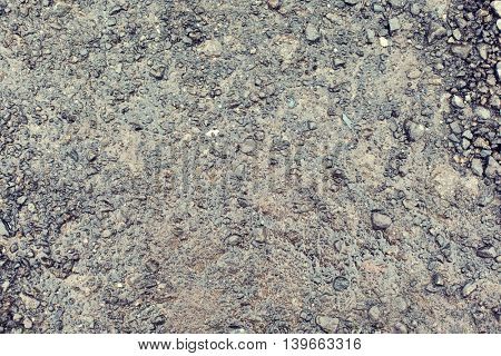 background and texture concept - close up of wet gray gravel road or ground