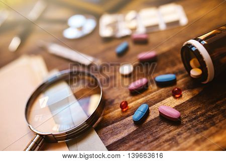 Colorful medical tablets and pills scattered on doctor's office desk healthcare and medicine concept image selective focus