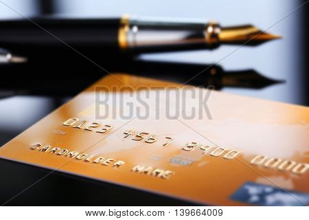 Credit card with pen, close up