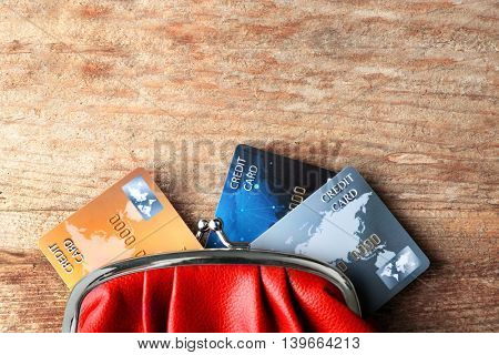 Credit cards in purse on wooden background