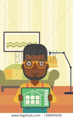 An african-american man showing a tablet computer with smart home application on a screen on the background of living room. Vector flat design illustration. Vertical layout.