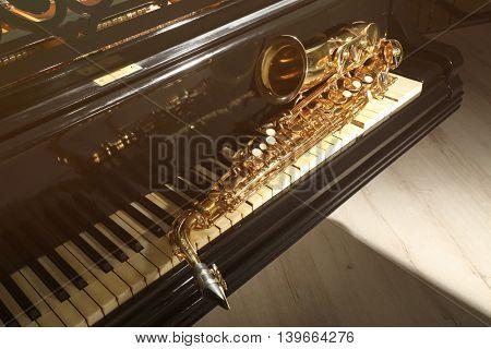 Piano and saxophone, closeup