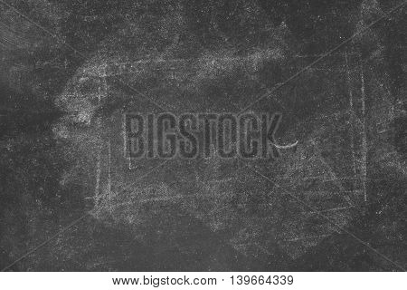 Retro toned dirty school blackboard with chalk marks texture as educational copy space background