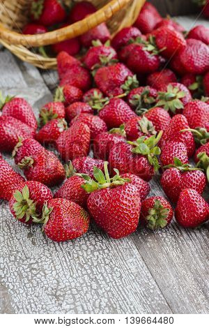 Fresh Strawberry Harvest Scattered On Rustic Wooden Table