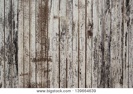 Weathered wooden background old painted planks texture