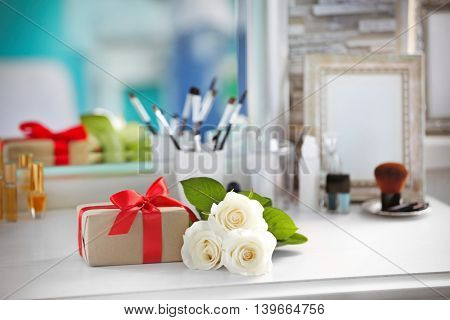 Present with cosmetic set on light dressing table