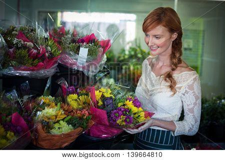 Female florist arranging flower bouquet in the flower shop