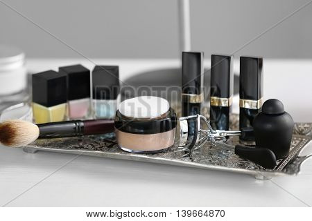 Cosmetic set on old silver tray