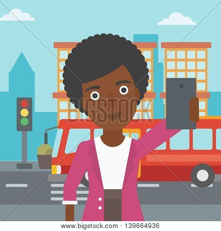 An african-american woman making selfie. Woman taking photo with cellphone. Woman looking at smartphone and taking selfie on the background of city. Vector flat design illustration. Square layout.