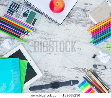 back to school hero header with school supplies on wooden table, copy space on wooden table