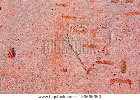 heart drawn in concrete pathway in red