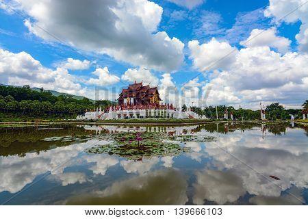 Chiang Mai, Thailand - July 22, 2016: Summer sky and Ho Kham Luang Pavilion reflecting in the pond at Royal Park Rajapruek.