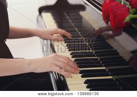 Girl playing on piano