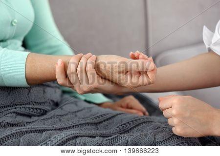Female doctor measuring pulse